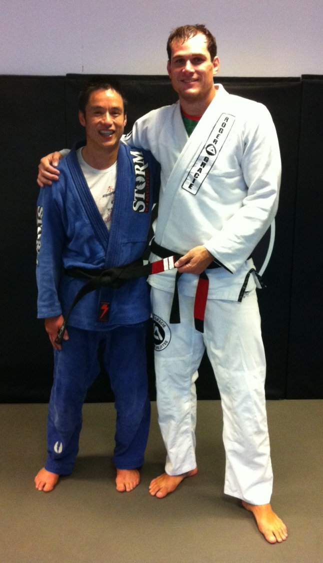 Kevin Chan receives 2 stripes on his black belt from Roger Gracie and Mauricio Gomes